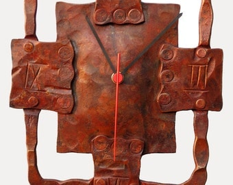 Geometric hand forged metal wall clock, rust finish, suitable for exterior