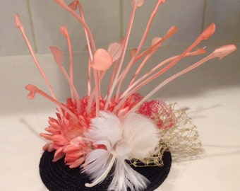 PETULA Fascinator with salmon silk flowers, veiling and feather accents. Handmade.