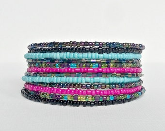 Memory wire bracelet. Hot pink, turqouise and multi colored seed beads