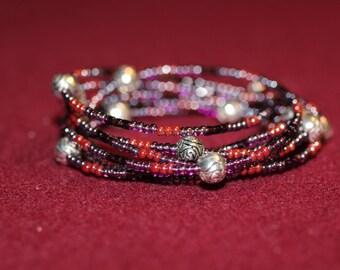 Purple beaded wrap bracelet with silver rose beads.