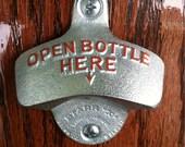Bottle opener, wall mounted, magnetic.