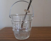 A French vintage Suze advertising ice bucket with handle and ice cube tongs