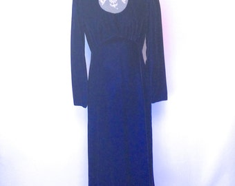 Vintage luscious dark blue velvet gown with lave inset at neckline and empire waist.