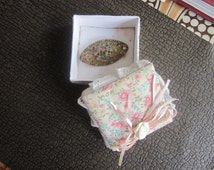 small box and a vintage broch