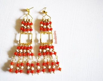 Earrings with red beads and cream