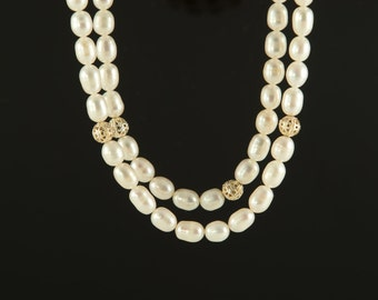 Necklace made with freshwater pearls and silver plated filigree beads.