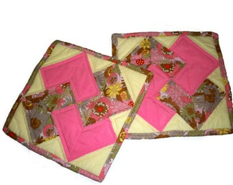Two Quilted Pot Holders or Hot Pads in pink, pale yellow, and beige fabrics
