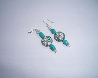 Pair of sterling silver fishhook earrings with green, white, and grey beads