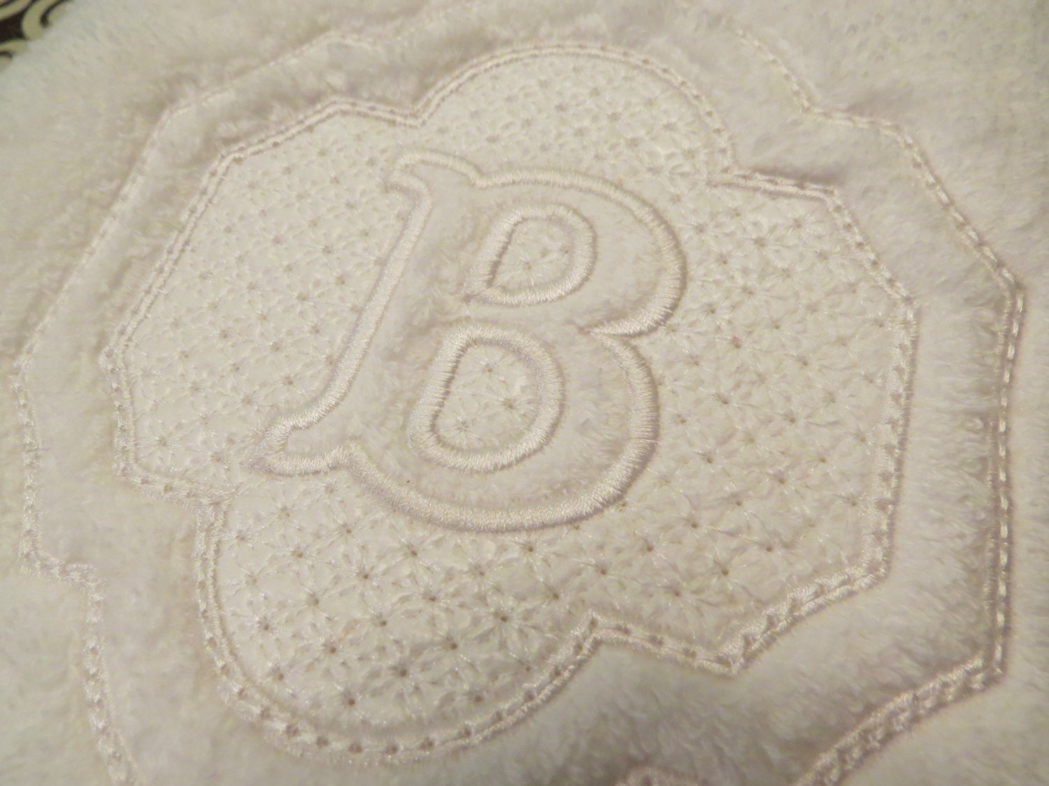 Embossed monogram hand towel by allstitchedupbyjill on etsy