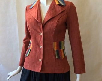 1970's crinkle cotton jacket, fitted, clay-red with with multicolor decorative waistband, collar, and pocket flaps, small