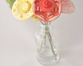 pink, red, and yellow button flower bottle bouquet