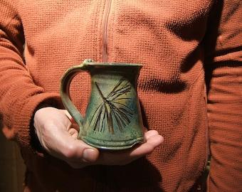 "ceramic coffee mug in ""Green Leaf Glaze"" with white pine"