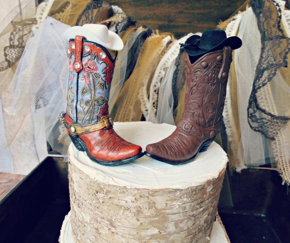 Custom his and hers cowboy boots wedding cake