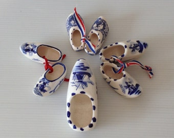 three pair + one of delft blue miniature shoes, windmill motif, hand painted, holland, miniature shoes