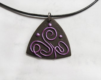 Confusion polymer clay pendant