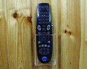 TV Cable or Satellite Decoder Receiver Remote Control Wall Holder Stand Display.