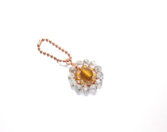 Wire beaded keychain in transparent white and amber color, with glass beads, copper wire wrapped accessories
