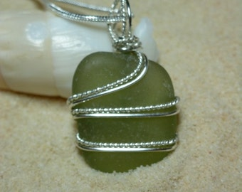 Wire wrapped green sea glass necklace with two kinds of wire and sterling silver chain