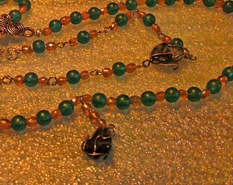 Caged green aventurine and beaded necklace and bracelet set.