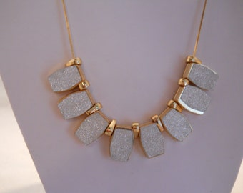 Choker Necklace with Gold Tone and Silver Tone Pendants on a Gold Tone Chain