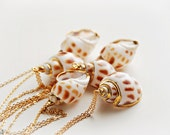 Seashell snail Necklace in white & light brown dipped in gold