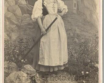 Switzerland young woman in ethnic peasant costume w rakes antique photo