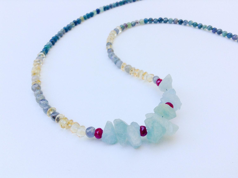 aquamarine and ruby gemstone necklace with cut