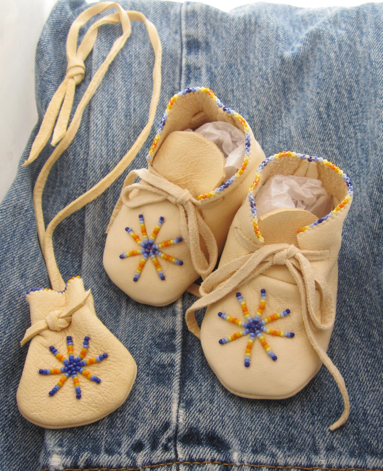Native made beaded moccasins for baby and beaded leather pouch for Native american handmade crafts