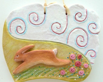rabbit bunny hare running swirly fluffy clouds pink flowers long grass hills fields cute dreamy imagination girly spirit clay decoration