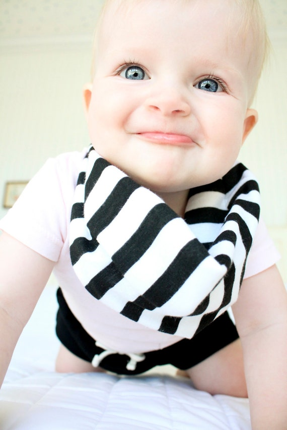 Teething is inevitable. Hooray for solid foods! But the drool that those impending chompers produce is unreal. Easier to change than a soaked-neckline onesie and more stylish than a traditional feeding bib, the bandana bib is a fresh way to keep the laundry at bay.