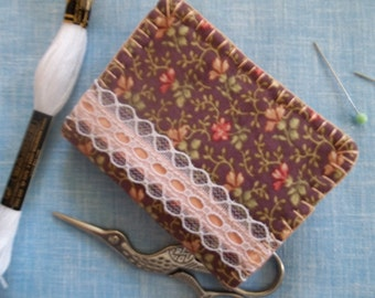 Floral print needle book with lace embellish..