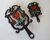 Cast Iron Wilton Trivets - Hearts, Birds, Brooms - Set of Two
