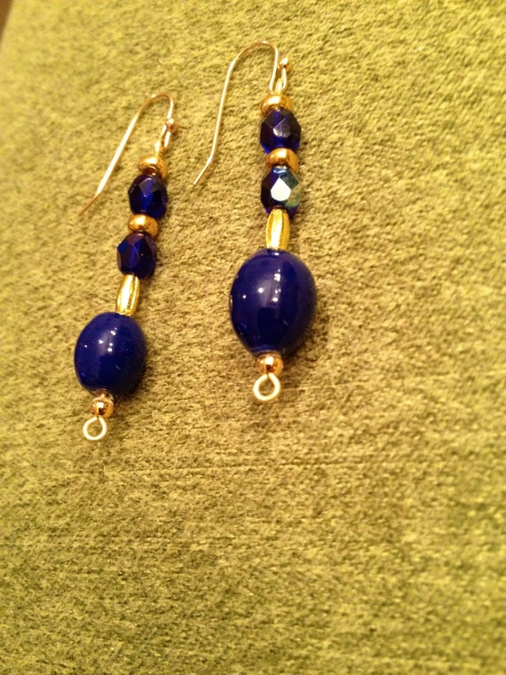 Earrings with blue ceramics oblong beads and marine blue Swarovski multifaceted crystals, golden seed and oblong beads
