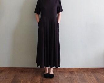 Minimalist pleated black maxi dress