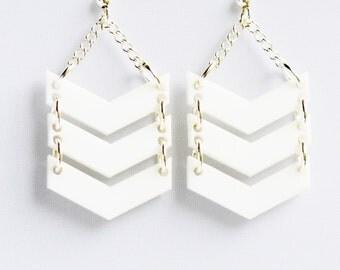 White laser cut acrylic triple chevron statement dangle earrings