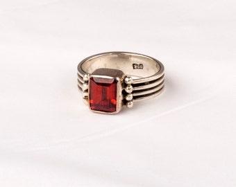 Art Deco Vintage Silver Ring with a fine Garnet gem.    Unique design.
