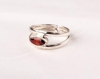 Stunning Vintage Silver ring with a Garnet gem. Unique design.