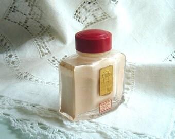 Vintage L'aimant De Coty - The Magnet - Perfume Powder Sachet Bottle  - 2 oz - glass bottle - red celluloid lid