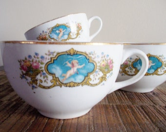 Set of Four Vintage Porcelain Cupid Tea Cups