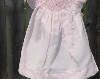 Smocked baby dress with angel sleeves