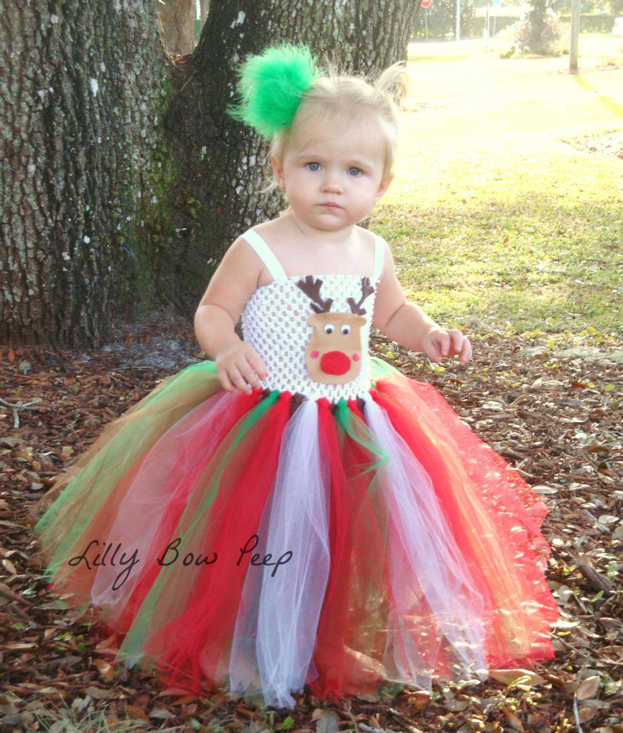 She'll love the twirl-worthy flourish of this tutu dress bedecked in festive colors to inspire her holiday spirit. Full graphic text: Merry Christmas.