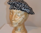 Blk and white leopard print beret, size small