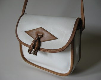 Preppy white and tan leather vintage purse magnetic snap closure cross body tassel detail