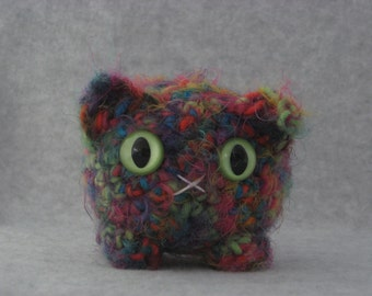Crocheted rainbow plush kitty