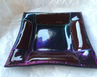 Iridescent (dichroic) fused glass dish in greens, purple, red