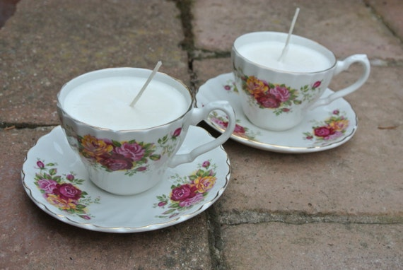 Tea cup candles with red, pink and orange flowers