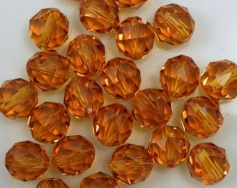 Swarovski 5025 8mm Topaz Round Faceted Bead