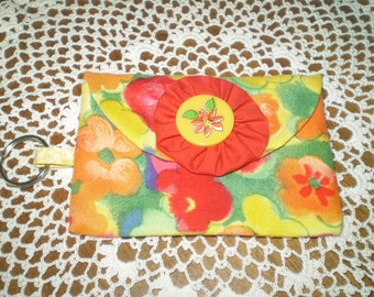 red, orange, yellow card keeper wallet- flowered button, fabric yoyo, velcro closure- key ring, cash, cards, coin purse