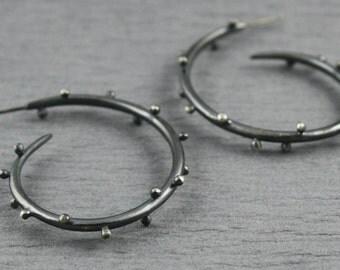 Large curvy polka dot hoop earrings