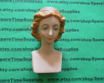 """Fibre Craft - 7689-03  doll head porcelain 2 1/2"""" brown hair  1 pc"""